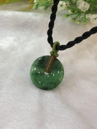 green jade coin pendant